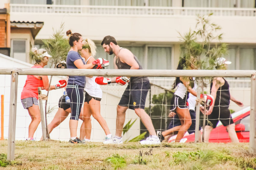 Boxing Exercise Exercising Architecture Building Exterior Built Structure Day Fitness Fitness Training Full Length Grass Healthy Lifestyle Leisure Activity Lifestyles Outdoors Real People Togetherness Women Young Adult