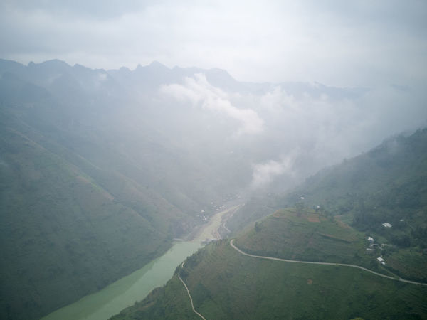 Fantastic landscape view of mountains, river, valley and road along Ma Pi Leng pass in Dong Van and Meo Vac UNESCO National Geopark in Ha Giang, Vietnam. Dong Van