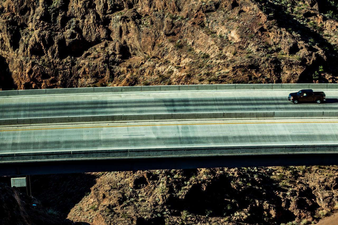 Car on suspension bridge