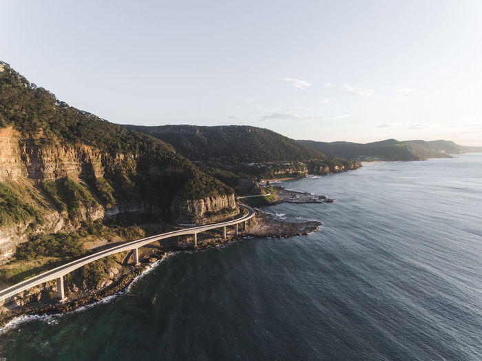 A Bird's Eye View Aerial View Architecture Beauty In Nature Blue Bridge Cliff Coastline Day High Angle View Man Made Object Mountain Mountain Range Mountain Road Nature Outdoors Remote Rock Formation Scenics Sea Sky Tranquil Scene Tranquility Water Waterfront