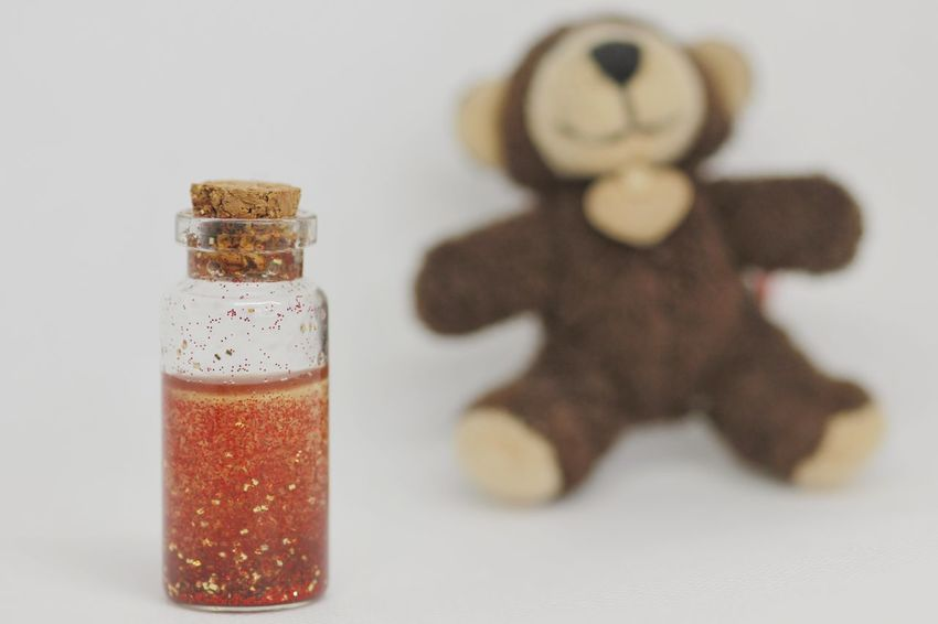 sparkling Bottle Glitter Glittering Glittering Waters Teddy Bear Teddybear Love Potion Magic Potion Magic Drinking Drink Drinks Teddy Tranquility Stuffed Toy EyeEm Selects Celebration Food And Drink Indoors  Christmas No People Jar Close-up Studio Shot White Background Freshness Food Day Sweet Food