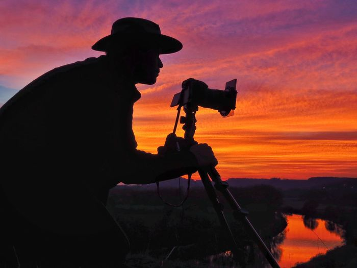 """Enjoy the colors of nature"" Sunset Silhouette Orange Color Real People One Person Leisure Activity Tripod Men Nature Lifestyles Photographing Photographer Camera - Photographic Equipment Side View Photography Themes Sky Technology Outdoors Beauty In Nature Standing Cowboy Michael Hruschka Photography Sonnenuntergang Nature"