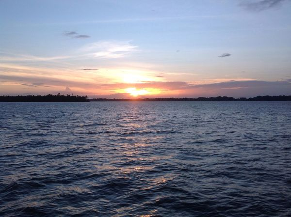 Fim de tarde no rio Tocantins Sunset Beauty In Nature Scenics Sea Tranquility Nature Tranquil Scene Water Sky No People Idyllic Sun Outdoors Rippled Cloud - Sky Day