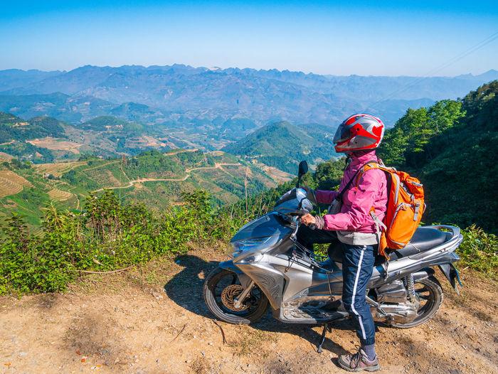 Man riding motorcycle sitting on mountain