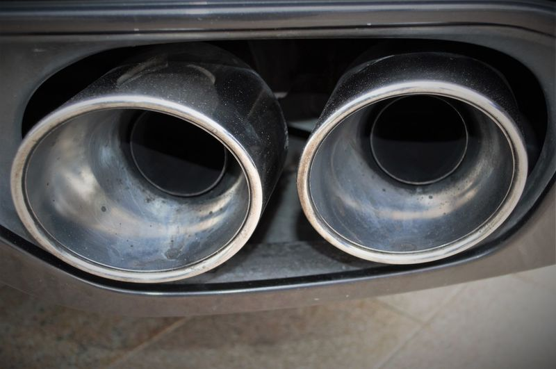 Cropped image of car exhaust pipe