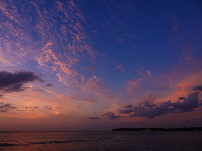 Sunset Sky Sea Water Beauty In Nature Scenics - Nature Sunset Tranquility Cloud - Sky Land Horizon Horizon Over Water Tranquil Scene Dramatic Sky Nature Beach Environment Dusk No People Outdoors Romantic Sky