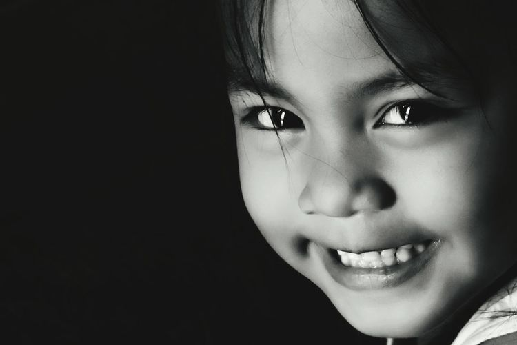 Childhood One Girl Only One Person Child Children Only Headshot Girls Portrait People Looking At Camera Human Face Human Body Part Close-up Happiness Smiling Black Background Indoors  Human Eye Day A6000photography A6000 Philippines Eyeem Philippines Innocence Innocent Eyes