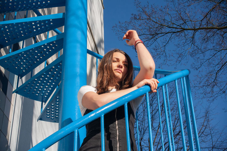 Low angle view of woman on slide at playground