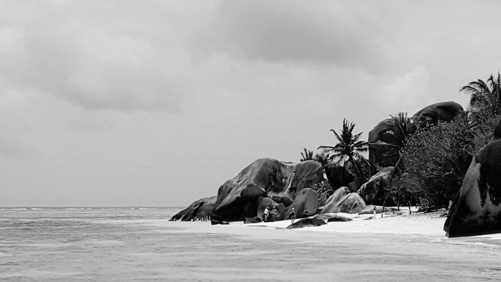 Monochrome Photography Sea Horizon Over Water Water Tranquil Scene Tranquility Scenics Sky Beach Rock - Object Shore Calm Idyllic Vacations Coastline Beauty In Nature Nature Summer Day Ocean Cloud - Sky Seychelles La Digue Anse Source D'argent Miles Away Black And White Friday Black And White Friday