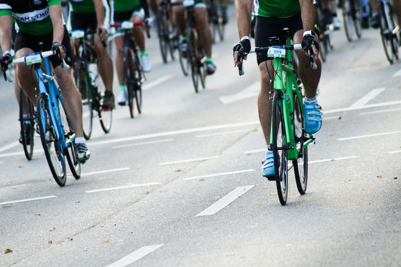 Low Section Of Athletes Cycling On Road During Race