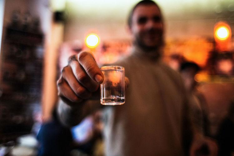 Man showing shot glass