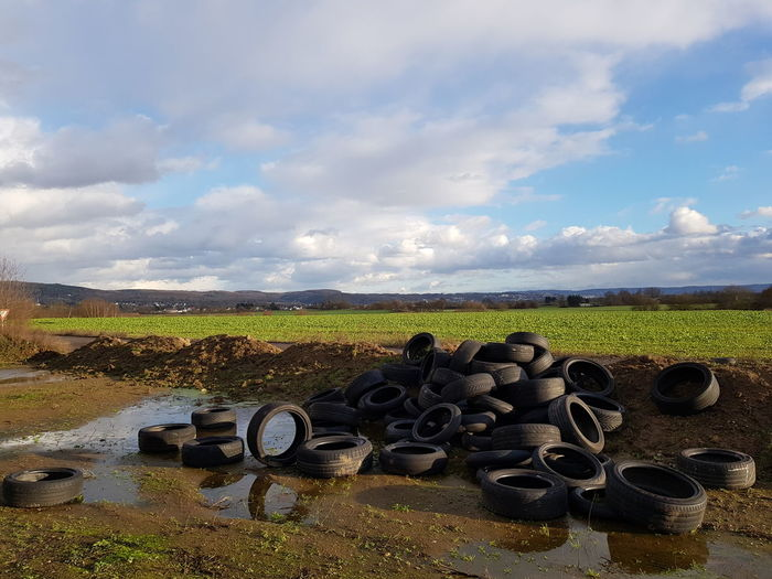 Illigal Farm Cultivated Photography Photography Agricultural Land Green Color Blue Color Bildfolge Landscape_Collection Clouds Scenics Cloud-sky Landscape_photography Environmental Pollution Environmental Protection Car Tire Tires Landscape