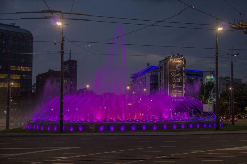 Impressive illuminated fountain on Slavija Square / Belgrade, Serbia Illuminated Street City Sky Architecture Night Building Exterior Built Structure Street Light Motion Road Transportation Fountain