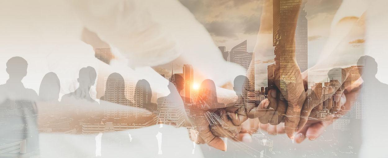 Digital composite image of man holding hands
