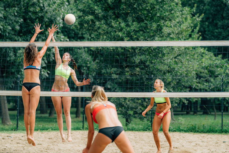 Female team playing beach volleyball