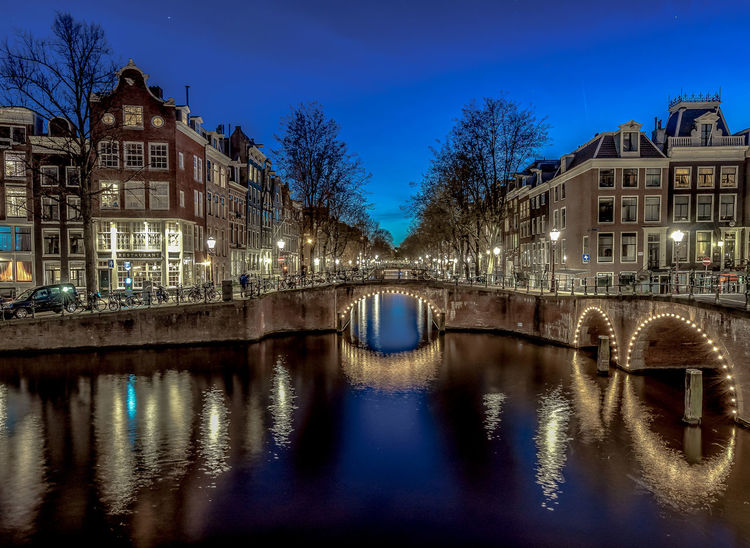 Amsterdam Architecture Bare Tree Blue Sky Bridge - Man Made Structure Building Exterior Built Structure Canal City Dusk Illuminated Keizersgracht Canal In Amsterdam, Netherlands Leidsegracht Leidseplein Night No People Outdoors Reflection River Sky Star - Space Travel Destinations Tree Water