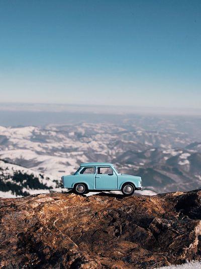 Blue car Alps