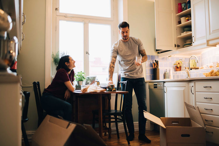 People standing by table at home