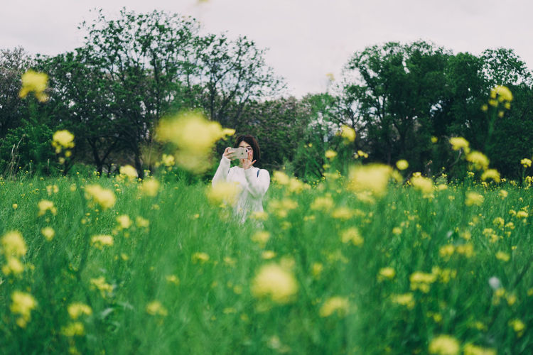 Woman on grassy field