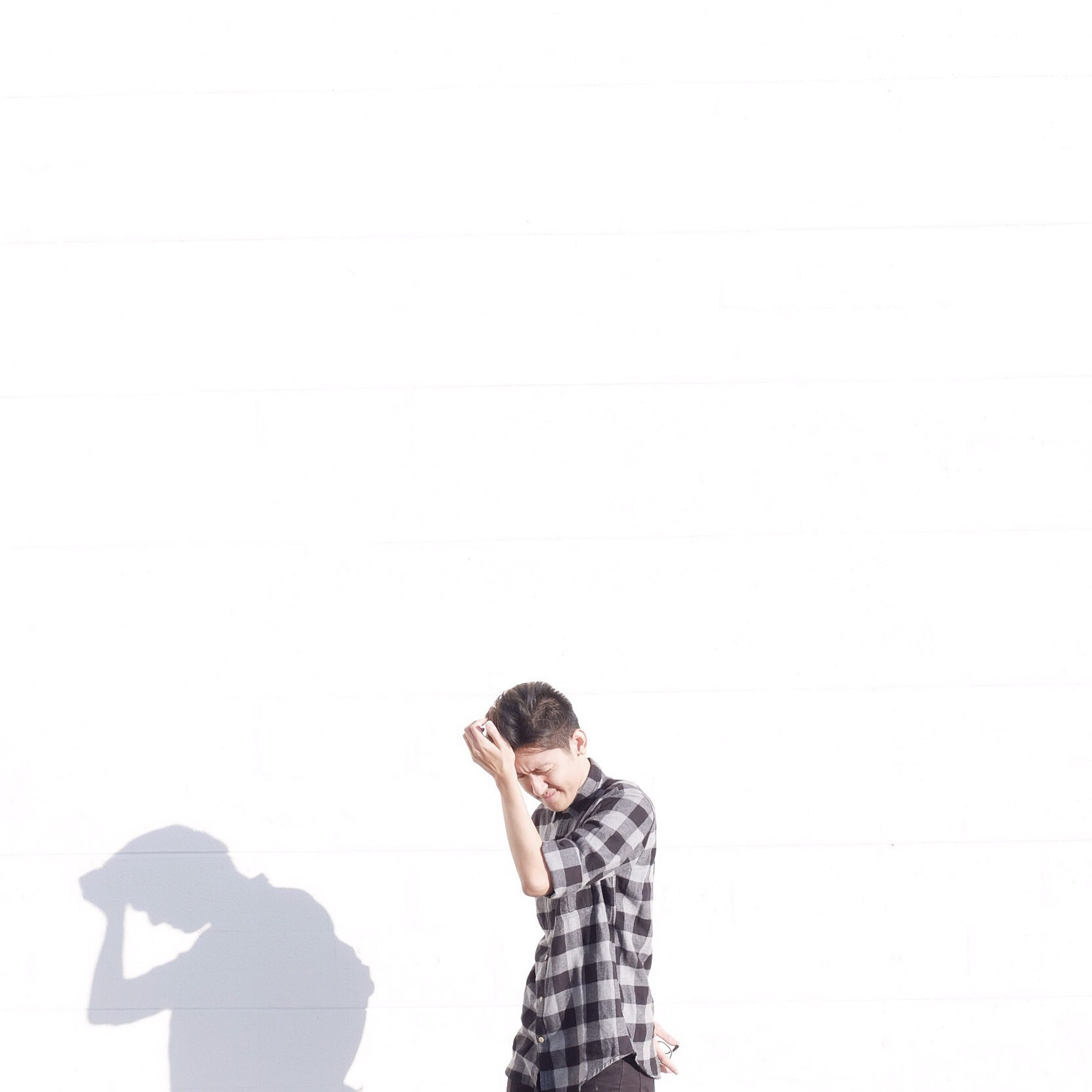 copy space, human representation, standing, art and craft, art, wall - building feature, white background, lifestyles, creativity, sculpture, studio shot, statue, casual clothing, young adult, front view, leisure activity, waist up