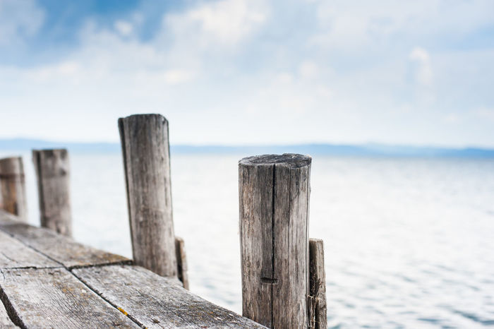 Wooden jetty side on quiet lake Close-up Cloud - Sky Day Dock Jetty Lake Landing Place Nature No People Nobody Outdoors Plank Sea Sky Tranquility Water Wood - Material