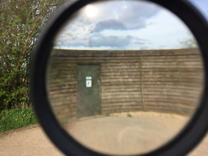 Through a magnifying glass Magnifying Glass Glass Shed Close-up Built Structure Outdoors Wildlife & Nature Outdoor Photography Beauty In Nature View Creativity Attenborough Nature Reserve Landscape Photographer Path Bird Hides Birdwatching Bird Photography Birdwatching