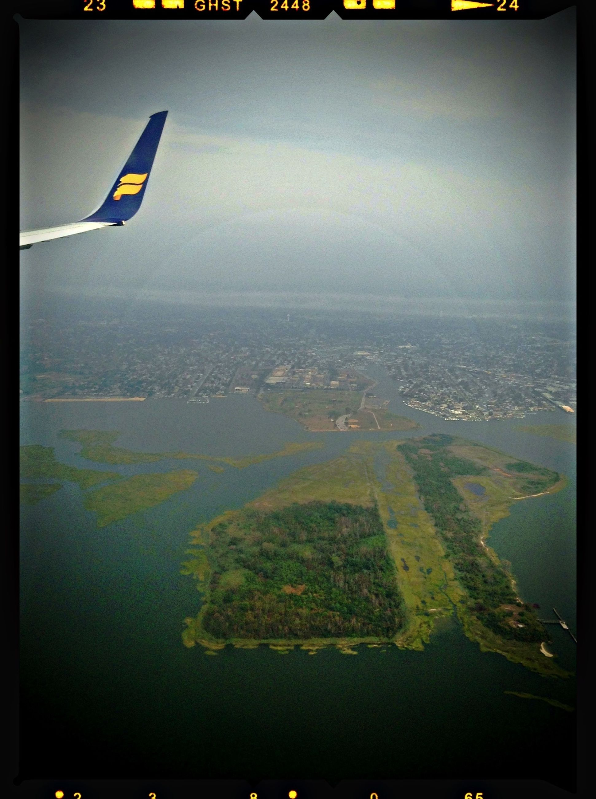 transportation, transfer print, mode of transport, auto post production filter, flying, airplane, air vehicle, aerial view, sea, aircraft wing, water, scenics, travel, sky, mid-air, beauty in nature, nature, tranquil scene, landscape, journey