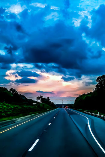 Sunset Illuminated Road Mountain Rural Scene Car Dusk Dramatic Sky Highway Sky The Traveler - 2018 EyeEm Awards