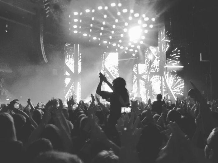 People enjoying in music concert at nightclub