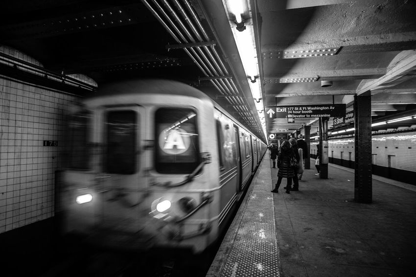 During my NY visit. Absence Black Black And White Blurred Motion City Life Depth Of Field Illuminated Indoors  Land Vehicle Mode Of Transport Narrow New York NYC Photography Passenger Train Public Transportation Railroad Station Railroad Station Platform Railway Selective Focus Subway Station Subway Train Technology The Way Forward Train Train Station Trainphotography Trainstation Transportation Travel Urban Waiting For A Train Washington Heights