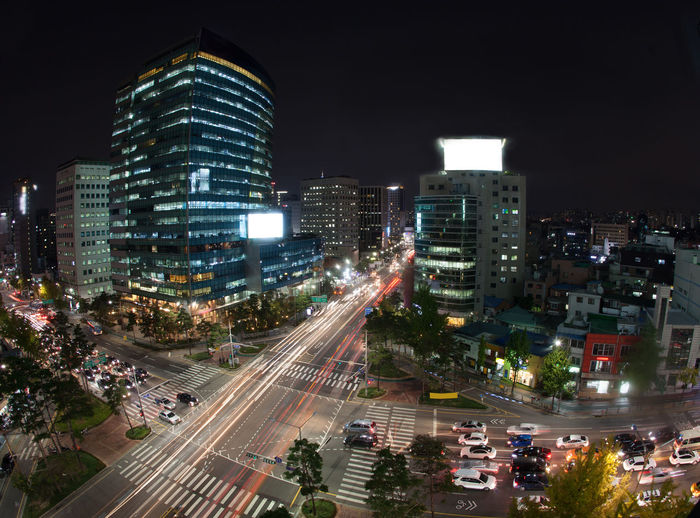 High angle shot of night metropolis Seoul in South Korea. Illuminated buildings and busy city motorways Architecture ASIA Car City City Life Cityscape Horizontal Illuminated Metropolis Modern Motion Motorway Night Outdoors Panorama Road Seul South Korea Speed Traffic Travel Destinations Urban Skyline