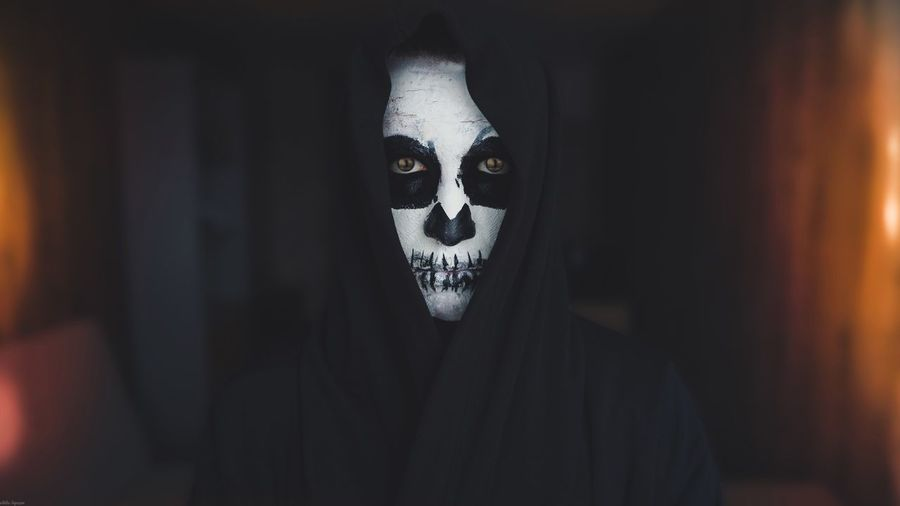 Portrait Of Person Wearing Ghost Make-Up At Home During Halloween