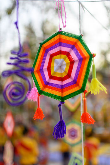 Close-up of multi colored decoration hanging on tree