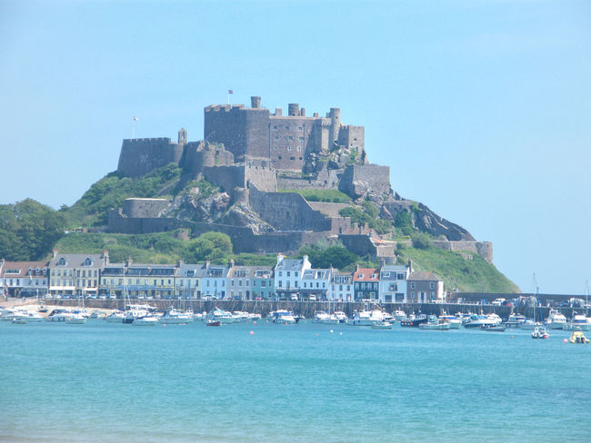 Castle Gorey Castle Jersey Mont Orgueil Mount Orgueil Castle Architecture Beauty In Nature Blue Building Exterior Built Structure Clear Sky Day Gorey History Mountain Nature Nautical Vessel No People Outdoors Sea Sky Water Waterfront