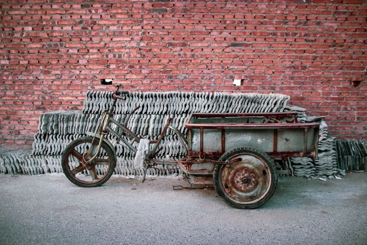 Street Photography Streetphotography Work China Brick Wall Wall Brick Wall Brick Transportation Wall - Building Feature Mode Of Transportation Architecture Built Structure Land Vehicle No People Building Exterior Day Cart City Street Old Outdoors Red Stationary My Best Travel Photo