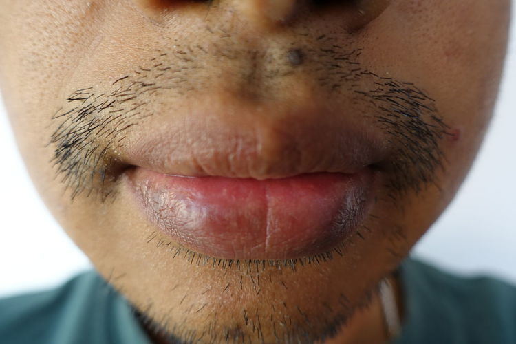 Close-up of young man lips