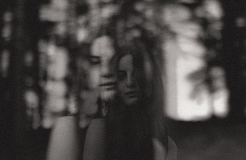 Double exposure of smiling woman