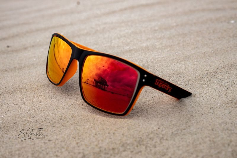 Beach Superdry EyeEm Selects Glasses Sunglasses Fashion Sand Personal Accessory Beach Land Protection Reflection Still Life Close-up Nature No People Sunlight Focus On Foreground Single Object Outdoors Glass - Material Day