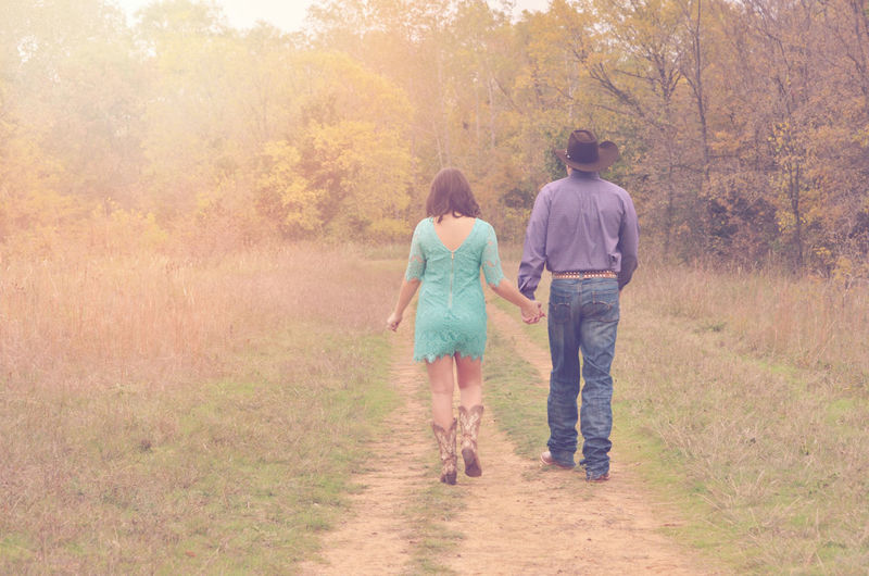 Couple Walking Casual Clothing Country Road Couple Day Engagement Family Footpath Friendship Grass Growth Holding Hands Holding Hands And Walking Leisure Activity Love Nature Outdoors Rear View The Way Forward Tree Walking