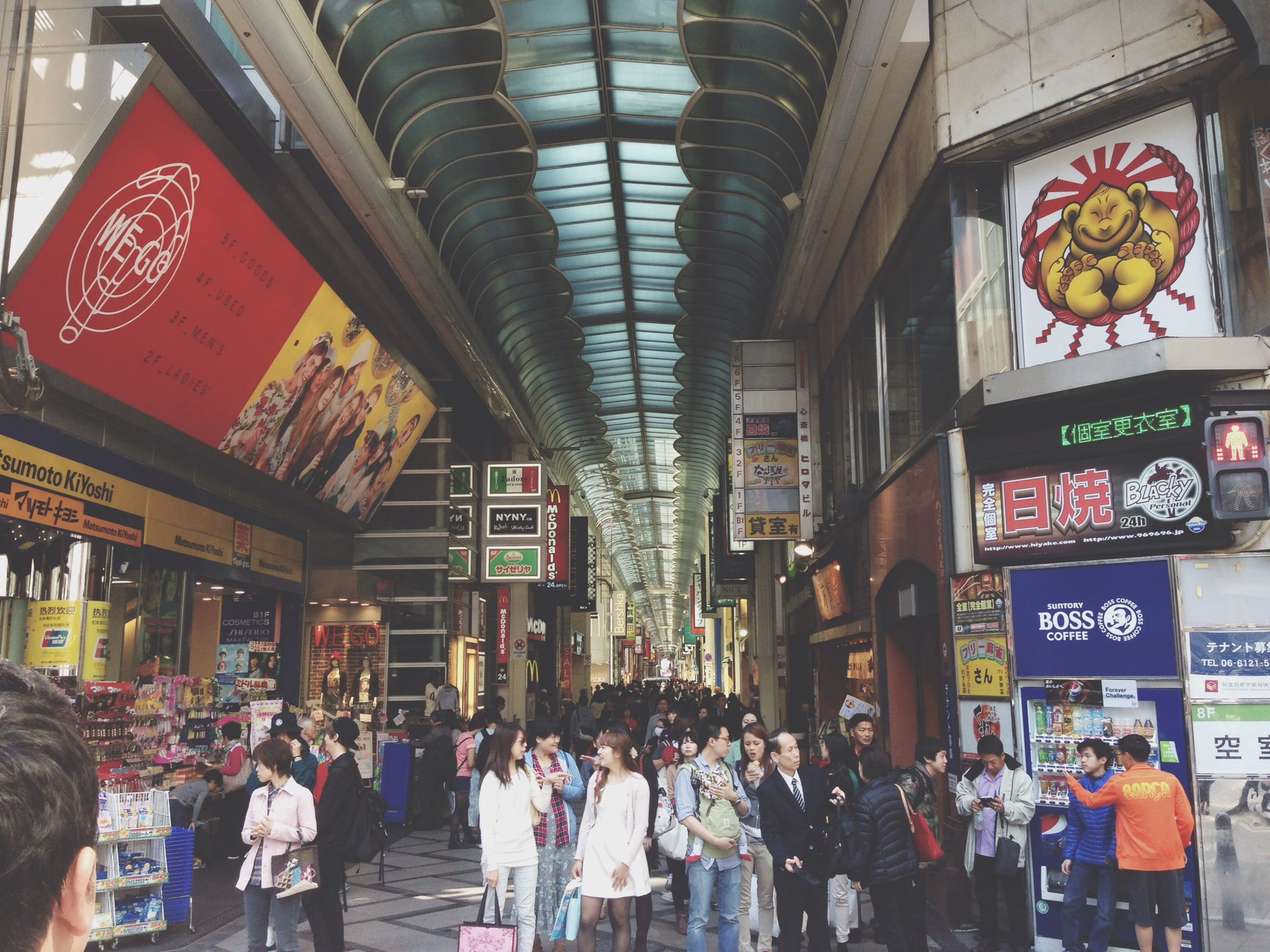 large group of people, person, men, architecture, built structure, lifestyles, indoors, shopping, market, retail, city life, illuminated, walking, crowd, leisure activity, store, market stall, non-western script, text
