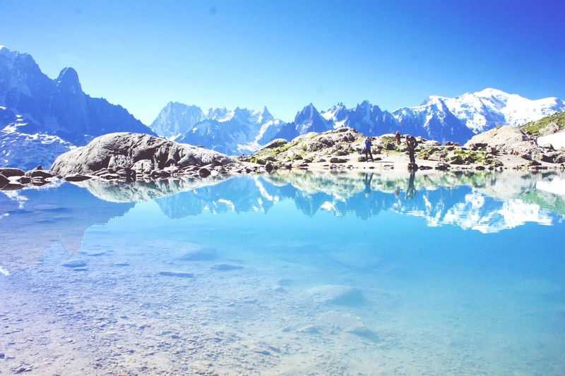 Scenic view of lac blanc and mountains against sky
