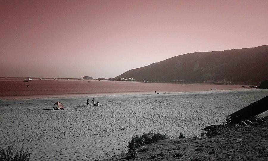 Red skys Avila Beach CA Dog Beach Daydreaming Eye4photography  MyWorldProductions Taking Photos EyeEm Gallery Enjoying Life Eye4photography  Hello World Urbanphotography Vacation Clouds And Sky Clouds Ocean View Sand & Sea Sand EyeEmBestPics Minimaledits Landscape_Collection People Photography