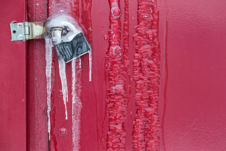 Close-up of frozen padlock on closed door