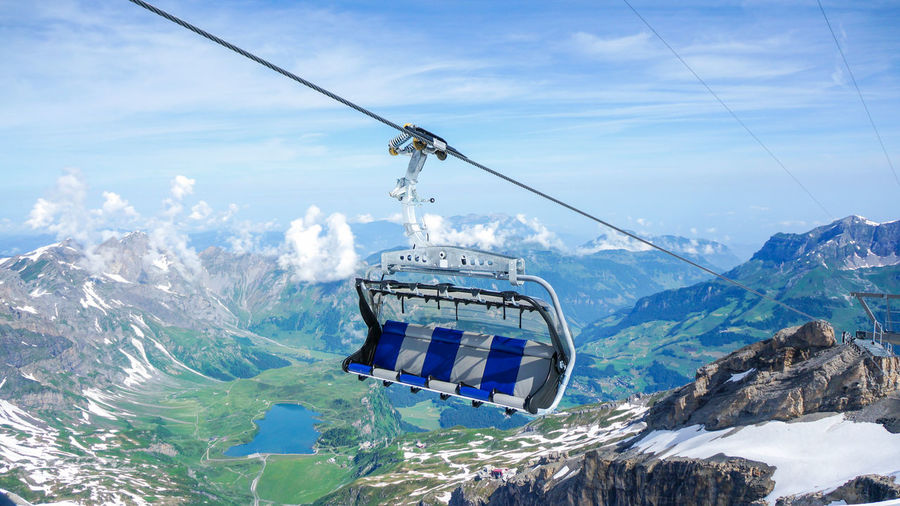 Suspended ropeway in Alps. Titlis, Engelberg, Switzerland. Beauty In Nature Blue Cable Cloud Cloud - Sky Day Idyllic Landscape Majestic Mountain Mountain Range Nature No People Non-urban Scene Outdoors Overhead Cable Car Scenics Season  Sky Snowcapped Mountain Tourism Tranquil Scene Tranquility Travel Destinations Weather