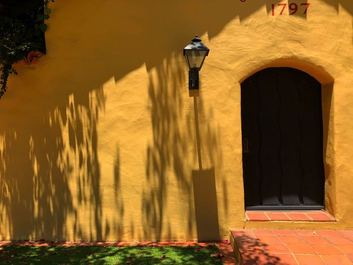 Building Exterior Built Structure Architecture Building Sunlight Nature Shadow Wall - Building Feature Day The Past History Old No People Plant Entrance Yellow Architectural Column Outdoors Arch