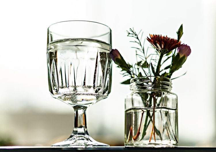 Close-up of wineglass on glass table
