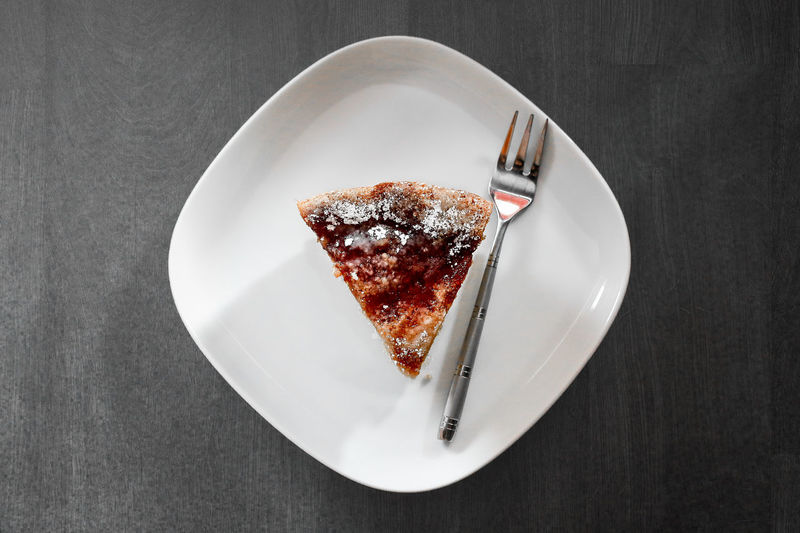 Directly Above Shot Of Cake Slice Served In Plate On Table