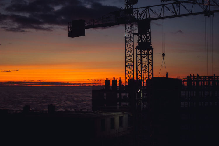 Sky Sunset Water Sea Silhouette Architecture Cloud - Sky Orange Color Nature Built Structure No People Scenics - Nature Beauty In Nature Machinery Industry Outdoors Construction Industry Crane - Construction Machinery Tranquility