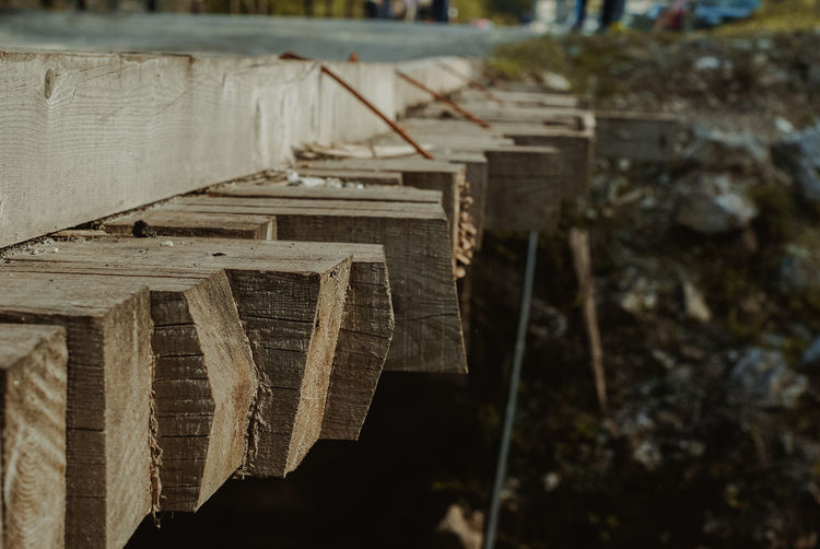Close-up of old wooden structure on field