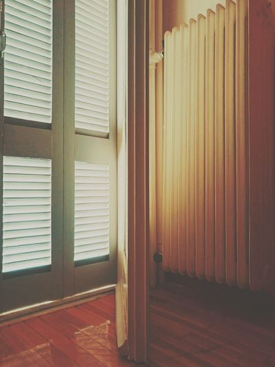 Door Indoors  Shutter Domestic Room No People Architecture Autumn Radiator Geometric Shape Day Getting Inspired Sony Mobile XperiaM5 Sony Xperia Mobile Photography From My Point Of View Wood - Material Sun Light Window Blinds Afternoon EyeEm Best Shots Our Best Pics Light And Shadow Absence